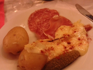 raclette cheese with potatoes salami and gherkins